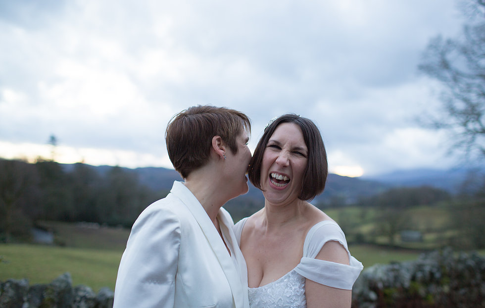 Two brides laughing in the Lake District