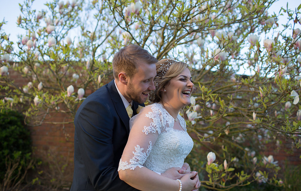 Bride and groom laughing at Colshaw Hall