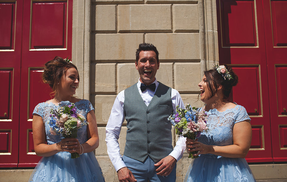 Grom laughing with bridesmaids outside Windsor Guildhall