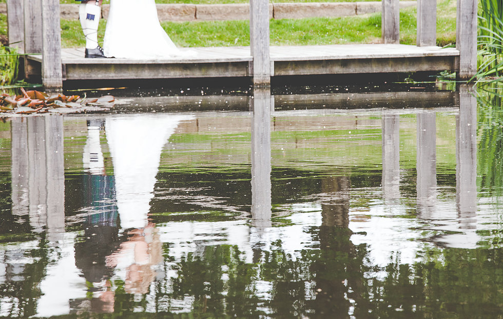 Reflection of couple at The Moat House, Staffordshire