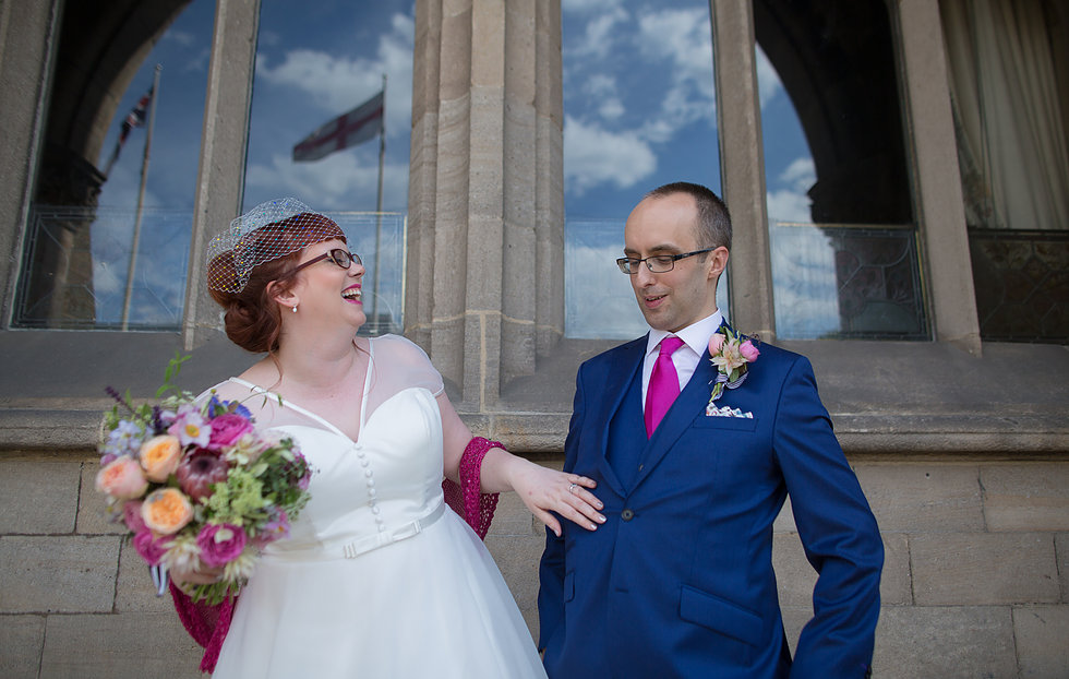Bride in glasses and groom laughing