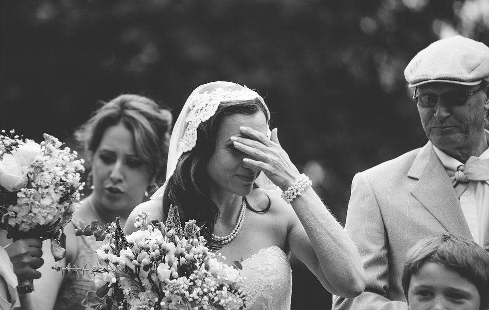 Black and white photo of bride who has forgotten wedding rings!
