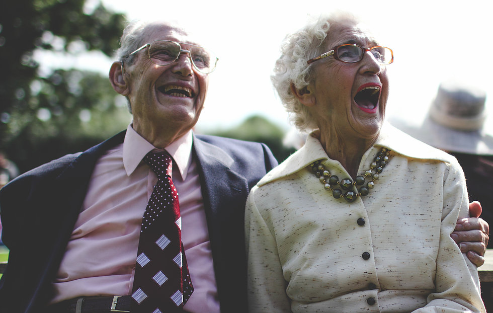 Old couple at wedding laughing