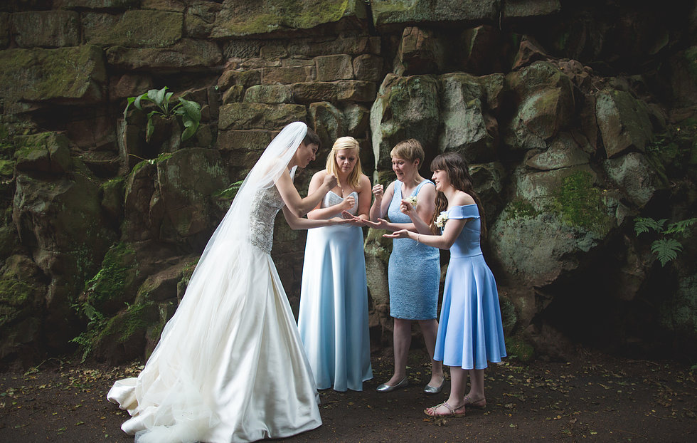 Bride playing rock, paper, scissors with bridesmaids in Keele, Staffordshire