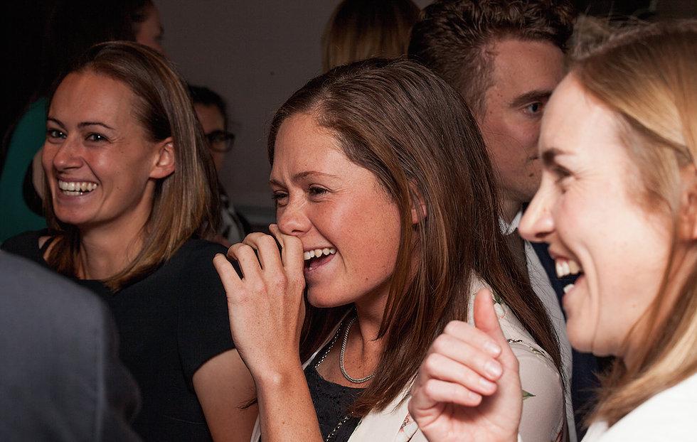 Wedding guests laughing in Chislehurst