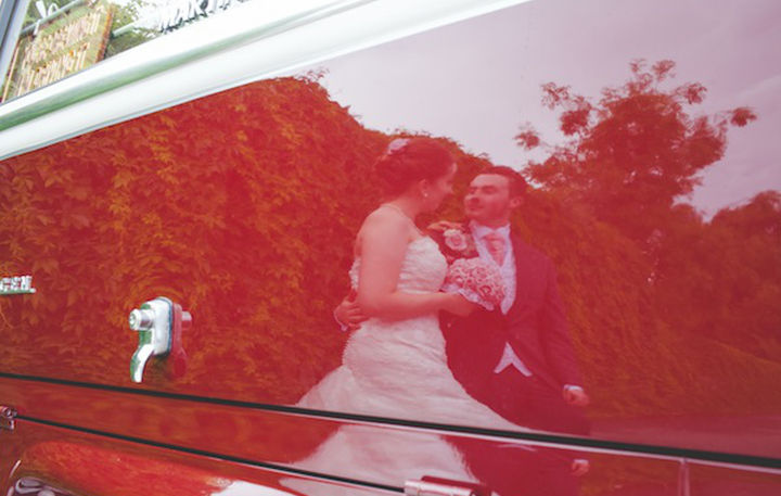 Photo of bride and groom in Stafford taken in the reflection of a vw camper van