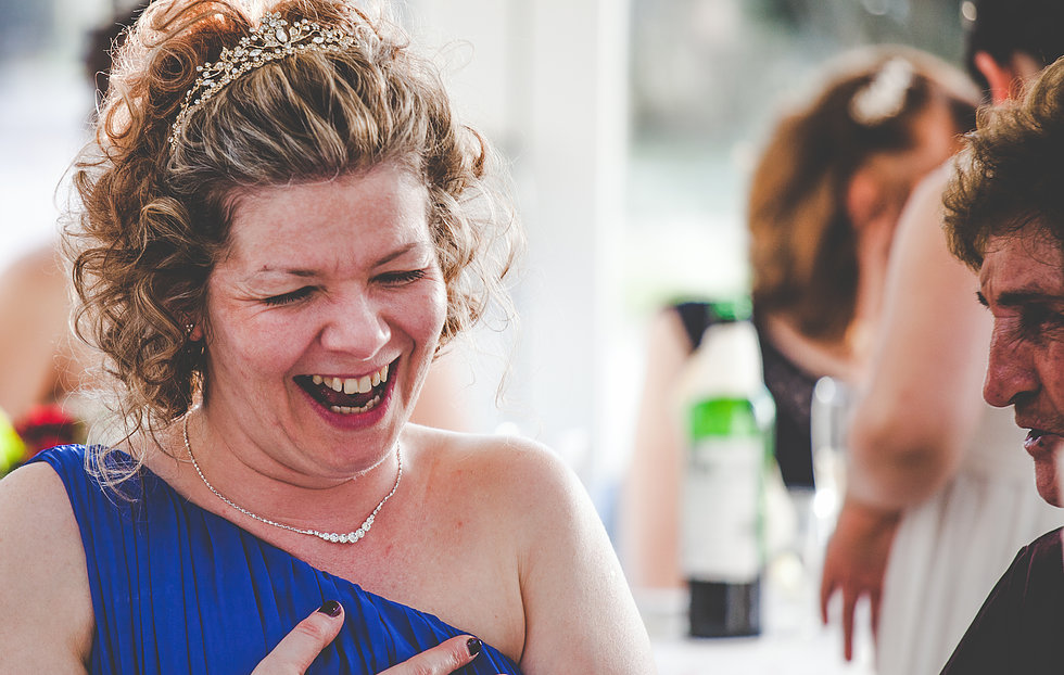 Guest laughing during the wedding breakfast