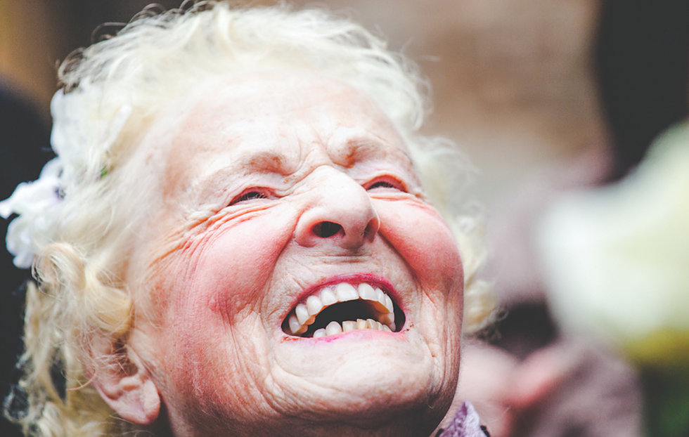 Grandparent laughing at wedding at Birtsmorton Court