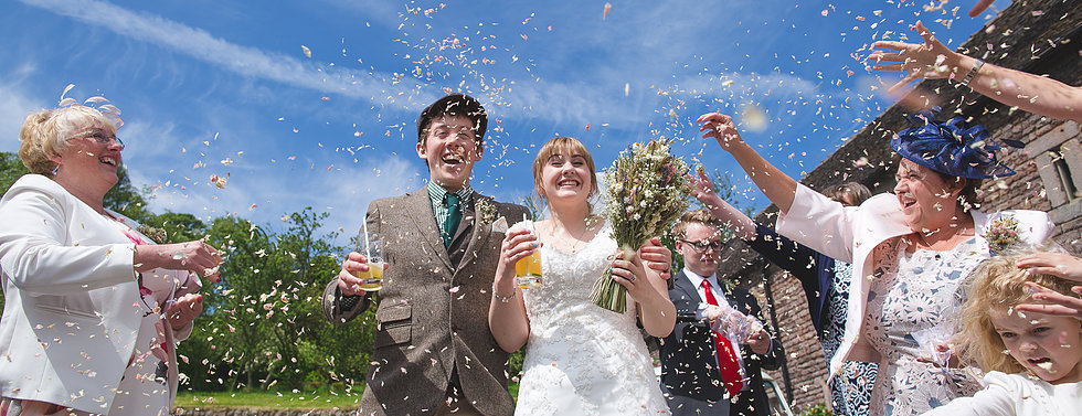 Confetti being thrown at couple at The Ashes in Staffordshire