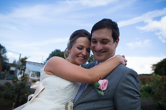 Groom holding bride at Sugnall Walled Gardens